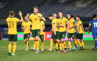 epa09253919 Harry Souttar (3-L) of Australia celebrates with teammates after scoring the 1-0 lead during the Asian Qualifiers for the FIFA World Cup 2022 and AFC Asian Cup 2023 group B soccer match between Australia and Taiwan at Jaber Al-Ahmad International Stadium in Kuwait City, Kuwait, 07 June 2021.  EPA/Noufal Ibrahim