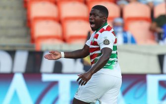 HOUSTON, TX - JULY 20: Nigel Hasselbaink #9 of Suriname celebrates after scoring 2nd goal during a group C match between Suriname and Guadeloupe as part of 2021 CONCACAF Gold Cup at BBVA Stadium on July 20, 2021 in Houston, Texas. (Photo by Omar Vega/Getty Images)