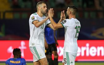 epa07688342 Islam Slimani of Algeria (L) celebrates scoaring the 0-1 goal with teammate Andy Delort (R) during the 2019 Africa Cup of Nations match between Tanzania and Algeria in Cairo, Egypt, 01 July 2019.  EPA/Samuel Shivambu