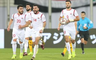 epa07286889 Syria's Omar Al Soma (R) celebrates with team mates after scoring the 2-2 goal during the 2019 AFC Asian Cup group B preliminary round match between Australia and Syria in Al Ain, United Arab Emirates, 15 January 2019.  EPA/ALI HAIDER