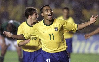 RIO DE JANEIRO, BRAZIL - SEPTEMBER 3:  Brazil's Romario celebrates his third goal in the game against Bolivia 03 September, 2000, during the World Cup 2002 qualification game in Maracana Stadium in Rio de Janeiro. Brazil won 5-0.  (ELECTRONIC IMAGE)  (Photo credit should read VANDERLEI ALMEIDA/AFP/Getty Images)
