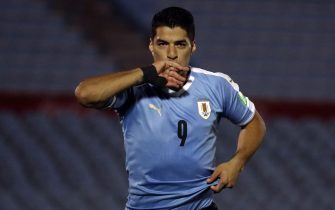 epa08730684 Luis Suarez of Uruguay celebrates after scoring during the South American qualifiers to the 2022 Qatar World Cup soccer match between national soccer teams of Uruguay and Chile, at Centenario stadium in Montevideo, Uruguay, 08 October 2020.  EPA/Raul Martinez / POOL