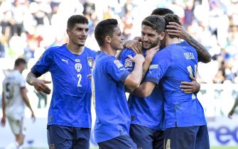 epa09516763 Domenico Berardi (C) of Italy celebrates with teammates after scoring the 2-0 lead from the penalty spot during the UEFA Nations League third place soccer match between Italy and Belgium in Turin, Italy, 10 October 2021.  EPA/Alessandro di Marco