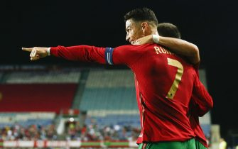 epa09515712 Portugal's player Cristiano Ronaldo celebrates a goal during the international friendly soccer match Portugal vs Qatar at Algarve held at Algarve stadium in Faro, Portugal, 09 October 2021. Portugal will face Luxembourg for the FIFA World Cup Qatar 2022 qualifying Group A soccer match next 12 October.  EPA/ANTONIO COTRIM