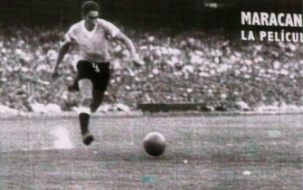 epa03958817 The historic winning goal against Brazil made by Uruguayan player Alcides Edgardo Ghiggia in the 1950 World Cup in Brazil, is shown in a giant screen at the Centenario Stadium in Montevideo, Uruguay, 20 November 2013, prior to the play off match of the Brazil World Cup 2014 held between Uruguay and Jordan.  EPA/Iván Franco