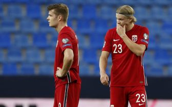 epa09101846 Norway's strikers Erling Haaland (R) and Bjorn Johnsen (L) react during the Group G of FIFA World Cup Qatar 2022 qualifier soccer match between Norway and Turkey held at La Rosaleda stadium, in Malaga, southern Spain, 27 March 2021.  EPA/Jorge Zapata