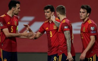 epa09109539 Spain's striker Gerard Moreno (2-L) celebrates with his teammates after scoring the 4-1 lead during their FIFA World Cup 2022 Qualifying round - Group B soccer match between Spain and Kosovo at La Cartuja stadium in Seville, Andalusia, Spain, 31 March 2021.  EPA/Julio Munoz