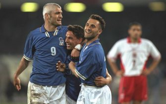 30 Apr 1997:  Roberto Baggio of Italy (centre) is congratulated by Fabrizio Ravanelli (left) and Angelo Di Livio after his goal during the World Cup Qualifier against Poland in Naples, Italy. Italy won 3-0. \ Mandatory Credit: Ben Radford /Allsport