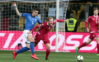 Italy's Gianluca Mancini  (L) and Liechtenstein's Simon Kuhne (R) in action during the UEFA EURO 2020 Group J qualifying soccer match Italy vs Liechtenstein at the Ennio Tardini stadium in Parma, Italy, 26 March 2019.ANSA/ELISABETTA BARACCHI