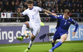 epa07923406 Italy's Giovanni Di Lorenzo (L) and Liechtenstein's Max Goeppel in action during the UEFA Euro 2020 qualifying, Group J soccer match between Liechtenstein and Italy in Vaduz, Liechtenstein, 15 October 2019.  EPA/GIAN EHRENZELLER