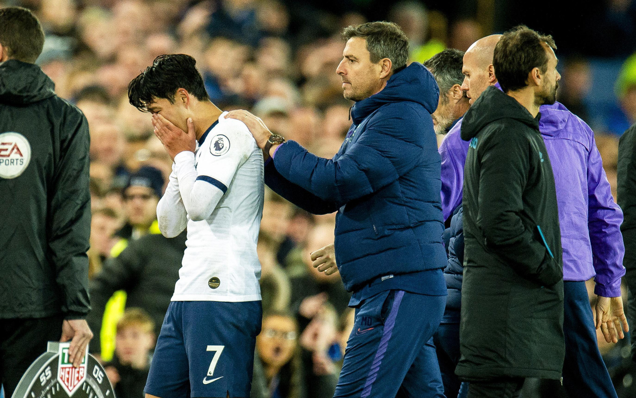 epa07970274 Tottenham Hotspur's Son Heung-min (L) reacts after tackling Everton's Andre Gomes causing an injury to the Everton player during the English Premier League soccer match between Everton FC and Tottenham Hotspur at the Goodison Park in Liverpool, Britain, 03 November 2019.  EPA/PETER POWELL EDITORIAL USE ONLY. No use with unauthorized audio, video, data, fixture lists, club/league logos or 'live' services. Online in-match use limited to 120 images, no video emulation. No use in betting, games or single club/league/player publications