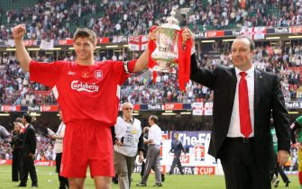 CARDIFF, United Kingdom:  Liverpool manager Raphael Benitez (R) and captain Steven Gerrard lift the FA Cup after Liverpool beat West Ham 3-1 on penalties during the FA Cup final at the Millennium Stadium in Cardiff, 13 May 2006. AFP PHOTO/PAUL ELLIS  (Photo credit should read PAUL ELLIS/AFP via Getty Images)