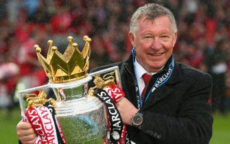 MANCHESTER, ENGLAND - MAY 12:  Manchester United Manager Sir Alex Ferguson celebrates with the Premier League trophy following the Barclays Premier League match between Manchester United and Swansea City at Old Trafford on May 12, 2013 in Manchester, England.  (Photo by Alex Livesey/Getty Images)