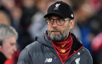 Liverpool's German manager Jurgen Klopp arrives for the English Premier League football match between Liverpool and Everton at Anfield in Liverpool, north west England on December 4, 2019. (Photo by Paul ELLIS / AFP) / RESTRICTED TO EDITORIAL USE. No use with unauthorized audio, video, data, fixture lists, club/league logos or 'live' services. Online in-match use limited to 120 images. An additional 40 images may be used in extra time. No video emulation. Social media in-match use limited to 120 images. An additional 40 images may be used in extra time. No use in betting publications, games or single club/league/player publications. /  (Photo by PAUL ELLIS/AFP via Getty Images)