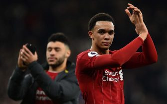 Liverpool's English defender Trent Alexander-Arnold applauds at the end of the English Premier League football match between Tottenham Hotspur and Liverpool at Tottenham Hotspur Stadium in London, on January 11, 2020. (Photo by Glyn KIRK / AFP) / RESTRICTED TO EDITORIAL USE. No use with unauthorized audio, video, data, fixture lists, club/league logos or 'live' services. Online in-match use limited to 120 images. An additional 40 images may be used in extra time. No video emulation. Social media in-match use limited to 120 images. An additional 40 images may be used in extra time. No use in betting publications, games or single club/league/player publications. /  (Photo by GLYN KIRK/AFP via Getty Images)