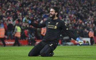 LIVERPOOL, ENGLAND - JANUARY 19: Alisson Becker of Liverpool celebrates the 2nd goal during the Premier League match between Liverpool FC and Manchester United at Anfield on January 19, 2020 in Liverpool, United Kingdom. (Photo by Michael Regan/Getty Images)