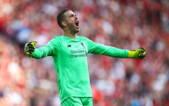 LIVERPOOL, ENGLAND - AUGUST 24: Adrian of Liverpool celebrates during the Premier League match between Liverpool FC and Arsenal FC at Anfield on August 24, 2019 in Liverpool, United Kingdom. (Photo by Robbie Jay Barratt - AMA/Getty Images)