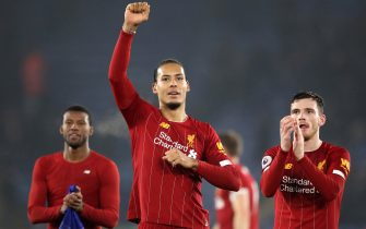 LEICESTER, ENGLAND - DECEMBER 26: Georginio Wijnaldum, Virgil van Dijk and Andy Robertson of Liverpool celebrate to their fans after the Premier League match between Leicester City and Liverpool FC at The King Power Stadium on December 26, 2019 in Leicester, United Kingdom. (Photo by Alex Pantling/Getty Images)