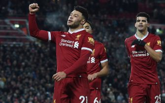 Liverpool's English midfielder Alex Oxlade-Chamberlain (L) celebrates scoring their fifth goal with Liverpool's English midfielder Trent Alexander-Arnold (C) and Liverpool's English striker Dominic Solanke (R) during the English Premier League football match between Liverpool and Swansea City at Anfield in Liverpool, north west England on December 26, 2017. / AFP PHOTO / PAUL ELLIS / RESTRICTED TO EDITORIAL USE. No use with unauthorized audio, video, data, fixture lists, club/league logos or 'live' services. Online in-match use limited to 75 images, no video emulation. No use in betting, games or single club/league/player publications.  /         (Photo credit should read PAUL ELLIS/AFP via Getty Images)