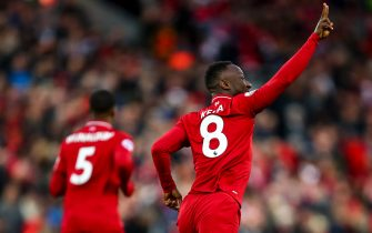 LIVERPOOL, ENGLAND - APRIL 26: Naby Keita of Liverpool celebrates after scoring a goal to make it 1-0 during the Premier League match between Liverpool FC and Huddersfield Town at Anfield on April 26, 2019 in Liverpool, United Kingdom. (Photo by Robbie Jay Barratt - AMA/Getty Images)