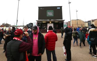 LIVERPOOL, ENGLAND - MARCH 07: A message from the NHS about the Coronavirus is seen on a screen outside the stadium prior to the Premier League match between Liverpool FC and AFC Bournemouth  at Anfield on March 07, 2020 in Liverpool, United Kingdom. (Photo by Jan Kruger/Getty Images)