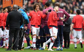 LONDON, ENGLAND - MARCH 07: David Luiz of Arsenal fist bumps his opposition over fears about the coronavirus prior to the Premier League match between Arsenal FC and West Ham United at Emirates Stadium on March 07, 2020 in London, United Kingdom. (Photo by Harriet Lander/Copa/Getty Images )
