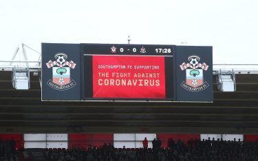 SOUTHAMPTON, ENGLAND - MARCH 07: A message in regards to the Covid-19 virus is displayed on a LED screen inside the stadium during the Premier League match between Southampton FC and Newcastle United at St Mary's Stadium on March 07, 2020 in Southampton, United Kingdom. (Photo by Charlie Crowhurst/Getty Images)