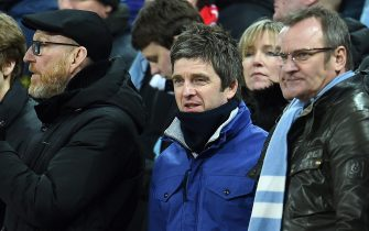 epa05185545 British musician Noel Gallagher (C) watches his team Manchester City against Liverpool during the English Capital One Cup final at Wembley Stadium in London, Britain, 28 February 2016.  EPA/ANDY RAIN EDITORIAL USE ONLY. No use with unauthorized audio, video, data, fixture lists, club/league logos or 'live' service. Online in-match use limited to 75 images, no video emulation. No use in betting, games or single club/league/player publications
