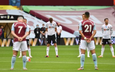 BIRMINGHAM, ENGLAND - JUNE 17: Chris Basham of Sheffield United takes part in a minute of silence commemorate the victims of the Covid-19 pandemic  during the Premier League match between Aston Villa and Sheffield United at Villa Park on June 17, 2020 in Birmingham, England. (Photo by Paul Ellis/Pool via Getty Images)
