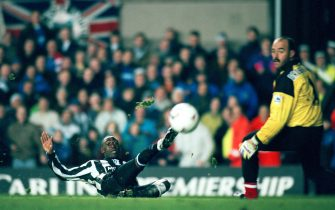 NEWCASTLE, UNITED KINGDOM - NOVEMBER 21:  Newcastle striker Andy Cole scores past Liverpool goalkeeper Bruce Grobbelaar during a 3-0 win to Newcastle during the FA Premier league match between Newcastle United and Liverpool at St James' Park on November 21, 1993 in Newcastle, England. (Photo by Shaun Botterill/Getty Images)