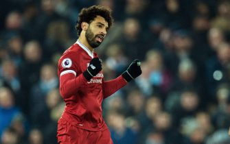 epa06438375 Liverpool's Mohamed Salah celebrates after scoring the 4-1 lead during the English Premier League soccer match between Liverpool FC and Mancheter City at Anfield in Liverpool, Britain, 14 January 2018.  EPA/PETER POWELL EDITORIAL USE ONLY. No use with unauthorized audio, video, data, fixture lists, club/league logos or 'live' services. Online in-match use limited to 75 images, no video emulation. No use in betting, games or single club/league/player publications