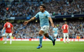 epa02738598 Manchester City's Carlos Tevez Celebrates Scoring 1st goal during the Premier League match between Manchester City and Stoke City at the City of Manchester Stadium, Eastlands, Manchester, Britain, 17 May 2011.  EPA/FOTOSPORTS/ROBIN PARKER NO ONLINE OR INTERNET USE WITHOUT A LICENSE FROM THE FOOTBALL DATA CO. LTD.