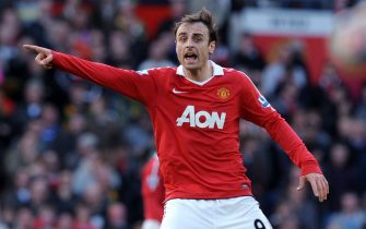 epa02642276 United's Dimitar Berbatov reacts during the Premier League match between Manchester United and Bolton Wanderers at the Old Trafford Stadium, Manchester, Britain, 19 March 2011.  EPA/ROBIN PARKER NO ONLINE OR INTERNET USE WITHOUT A LICENSE FROM THE FOOTBALL DATA CO. LTD.
