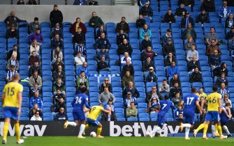 Socially distanced fans watch from the stands during the pre-season friendly football match between Brighton and Hove Albion and Chelsea at the American Express Community Stadium in Brighton, southern England on August 29, 2020. - The game is a 'pilot' event where a small number of fans will be present on a socially-distanced basis. The aim is to get fans back into stadiums in the Premier League by October. (Photo by Glyn KIRK / AFP) (Photo by GLYN KIRK/AFP via Getty Images)