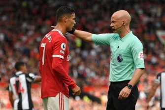Manchester United's Portuguese striker Cristiano Ronaldo (L) speaks with English referee Anthony Taylor (R) during the English Premier League football match between Manchester United and Newcastle at Old Trafford in Manchester, north west England, on September 11, 2021. - RESTRICTED TO EDITORIAL USE. No use with unauthorized audio, video, data, fixture lists, club/league logos or 'live' services. Online in-match use limited to 120 images. An additional 40 images may be used in extra time. No video emulation. Social media in-match use limited to 120 images. An additional 40 images may be used in extra time. No use in betting publications, games or single club/league/player publications. (Photo by Oli SCARFF / AFP) / RESTRICTED TO EDITORIAL USE. No use with unauthorized audio, video, data, fixture lists, club/league logos or 'live' services. Online in-match use limited to 120 images. An additional 40 images may be used in extra time. No video emulation. Social media in-match use limited to 120 images. An additional 40 images may be used in extra time. No use in betting publications, games or single club/league/player publications. / RESTRICTED TO EDITORIAL USE. No use with unauthorized audio, video, data, fixture lists, club/league logos or 'live' services. Online in-match use limited to 120 images. An additional 40 images may be used in extra time. No video emulation. Social media in-match use limited to 120 images. An additional 40 images may be used in extra time. No use in betting publications, games or single club/league/player publications. (Photo by OLI SCARFF/AFP via Getty Images)