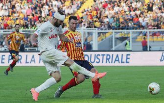 Filippo Falco of Lecce competes for the ball with Miralem Pjanic of Juventus during the Serie A match between US Lecce and Juventus at Stadio Via del Mare on October 27, 2019 in Lecce, Italy.