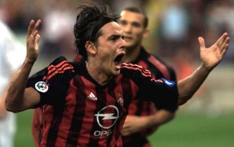 ROM05 - 20020814 - MILAN, ITALY : Milan soccer team player Filippo Inzaghi (C) cheers after scoring against Slovakian Slovan Liberec team during their Champions League soccer match in Milan on Wednesday, 14 August 2002. The match ended 1-0. EPA PHOTO ANSA/DAL ZENNARO/JI-ms