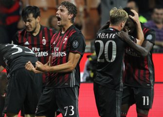 MILAN, ITALY - OCTOBER 02:  Manuel Locatelli of AC Milan celebrates his team-mates goal Gabriel Paletta during the Serie A match between AC Milan and US Sassuolo at Stadio Giuseppe Meazza on October 2, 2016 in Milan, Italy.  (Photo by Marco Luzzani/Getty Images)