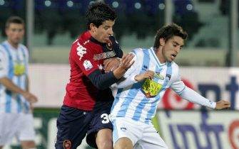 CAGLIARI, ITALY - DECEMBER 05:  Paolo Ceppelini of Cagliari competes for the ball with Juan Fernando Quintero (R) of Pescara during the TIM Cup match between Cagliari Calcio and Pescara at Stadio Is Arenas on December 5, 2012 in Cagliari, Italy.  (Photo by Enrico Locci/Getty Images)