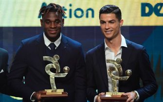 "Atalanta's Colombian forward Duvan Zapata (L) and Juventus' Portuguese forward Cristiano Ronaldo pose with their trophy of best forwards of the Italian Serie A football championship during the ""Gran Gala del Calcio"" Italian Football Association (Associazione Italiana Calciatori - IAC) awards ceremony on December 2, 2019, in Milan. (Photo by Miguel MEDINA / AFP) (Photo by MIGUEL MEDINA/AFP via Getty Images)"