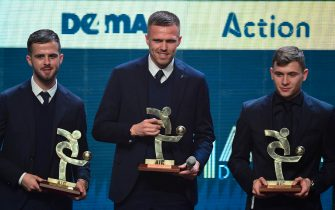 "Juventus' Bosnian midfielder Miralem Pjanic, Atalanta's Slovenian midfielder Josip Ilicic and Inter Milan's Italian midfielder Nicolo Barella pose with the award of the best midfielders  of the year of the Italian Championship Serie A the ""Gran Gala del Calcio"" Italian Football Association (Associazione Italiana Calciatori - IAC) awards ceremony on December 2, 2019, in Milan. (Photo by Miguel MEDINA / AFP) (Photo by MIGUEL MEDINA/AFP via Getty Images)"