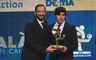 MILAN, ITALY - DECEMBER 02: Antonio Cabini gives to Sandro Tonali the best young player award during the 'Oscar del Calcio AIC' Italian Football Awards on December 2, 2019 in Milan, Italy. (Photo by Pier Marco Tacca/Getty Images)