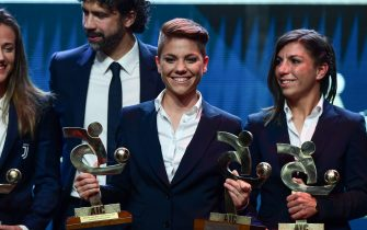 Roma's Italian midfielder Manuela Giugliano (C) reacts after receiving the Award for Best Female Player of the Year during the 'Gran Gala del Calcio' awards ceremony, organised by the Italian Footballers' Association (AIC), on December 2, 2019, in Milan. (Photo by MIGUEL MEDINA / AFP) (Photo by MIGUEL MEDINA/AFP via Getty Images)