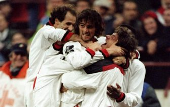 1995:  Marco Simone of AC Milan celebrates his goal with team mates during a match against Benfica at the Guiseppe Meazza Stadium in San Siro, Milan, Italy. \ Mandatory Credit: Clive  Brunskill/Allsport