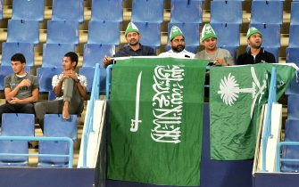 "Saudi fans cheer during a friendly football match between Saudi Arabia and Iraq for the ""Superclassico"" championship at King Saud University Stadium in Riyadh on October 15, 2018. (Photo by FAYEZ NURELDINE / AFP)        (Photo credit should read FAYEZ NURELDINE/AFP via Getty Images)"