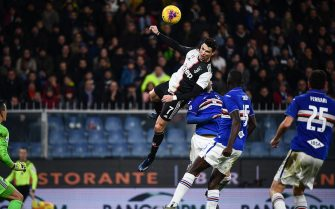 Juventus' Portuguese forward Cristiano Ronaldo (C) scores a header during the Italian Serie A football match Sampdoria vs Juventus on December 18, 2019 at the Luigi-Ferraris stadium in Genoa. (Photo by Marco Bertorello / AFP) (Photo by MARCO BERTORELLO/AFP via Getty Images)
