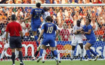 Berlin, GERMANY:  Italian defender Marco Materazzi jumps to score a goal during the World Cup 2006 final football match between Italy and France at Berlin?s Olympic Stadium, 09 July 2006.  AFP PHOTO/ARIS MESSINIS  (Photo credit should read ARIS MESSINIS/AFP via Getty Images)