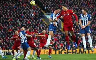 LIVERPOOL, ENGLAND - NOVEMBER 30:  Virgil van Dijk (R) of Liverpool scores his teams first goal with header during the Premier League match between Liverpool FC and Brighton & Hove Albion at Anfield on November 30, 2019 in Liverpool, United Kingdom. (Photo by Clive Brunskill/Getty Images)