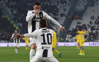 TURIN, ITALY - FEBRUARY 15: Paulo Dybala of Juventus celebrates with teammate Cristiano Ronaldo after scoring the opening goal during the Serie A match between Juventus and Frosinone Calcio on February 15, 2019 in Turin, Italy. (Photo by Tullio M. Puglia/Getty Images)