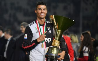 TURIN, ITALY - MAY 19: Cristiano Ronaldo of Juventus celebrates during the awards ceremony after winning the Serie A Championship during the Serie A match between Juventus and Atalanta BC on May 19, 2019 in Turin, Italy. (Photo by Tullio M. Puglia/Getty Images)